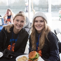 Friends Eating at Tailgate